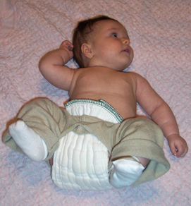 baby with prefold diaper tucked into waistband of split pants